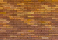 Brick wall with a difference. Background texture brown brick walls alternating with yellow variety is seamless Stock Photo