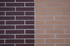 Brick wall. Of different colors with geometric shapes Stock Images