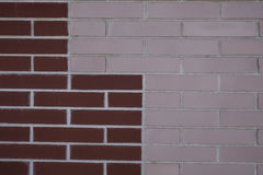 Brick wall. Of different colors with geometric shapes Stock Photos