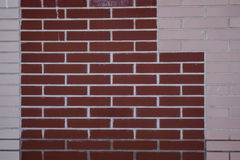 Brick wall. Of different colors with geometric shapes Stock Photo