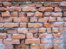 Brick wall with dilapidated red brick. Grunge wall background. Surface texture Royalty Free Stock Images