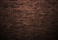 Brick wall. Dimly lit old brick wall