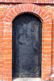 Brick wall and door of metal Stock Photo