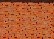 Brick wall with an alternating oblique pattern. Background and texture. Brick wall. Each oblique row has embossed bricks compared to the previous one, with an royalty free stock image