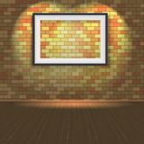Brick wall with a empty frame and lighting Royalty Free Stock Photography