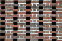 Brick Wall with Empty Spaces. A uniquely patterned brick wall in New York City Stock Photos