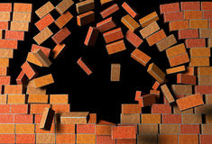 Brick Wall Explodes on Black Background Royalty Free Stock Photo