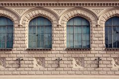Facade of a historic building with frontal windows stock images