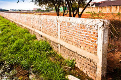 Brick wall fence. Fence placed a long brick wall. Village in Laos Stock Image