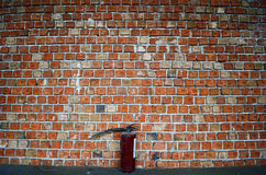 Brick Wall with fire extinguisher Royalty Free Stock Image