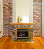 Brick wall and fireplace. Interior design of a luxury living room with a brick wall and fireplace Stock Photo