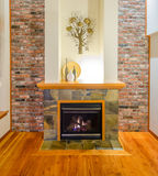 Brick wall and fireplace. Interior design of a luxury living room with a brick wall and fireplace Royalty Free Stock Photo