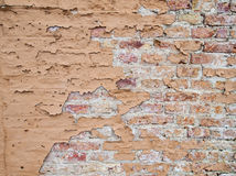 Brick wall with flaking paint Royalty Free Stock Images