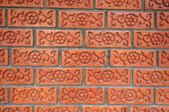 Brick wall with floral pattern Stock Image