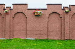 Brick wall with flower pots Royalty Free Stock Photography