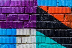 Brick wall with fragment of graffiti, abstract drawings art close-up. For background. Concept of Modern iconic urban Royalty Free Stock Photo