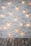 Brick wall with a garland of light bulbs. Stock Photos
