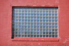Brick Wall Glass Block Window. A photograph of a brick wall and window made of square glass blocks royalty free stock image