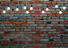 Brick wall with glowing light bulbs Stock Image