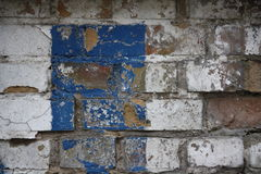 Brick wall with graffiti. Close up view of a brick wall wih white and blue graffiti Royalty Free Stock Image