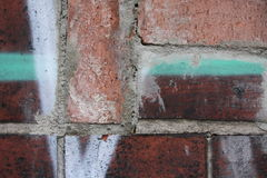 Brick wall with graffiti Royalty Free Stock Photo