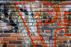 Brick wall with graffiti. Colorful scribbles and doodles Stock Image