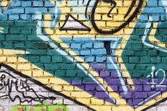Brick wall with graffiti Stock Photo