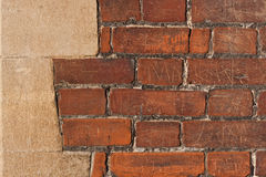 Brick wall with grafitti. Close up of a red brick wall Royalty Free Stock Image