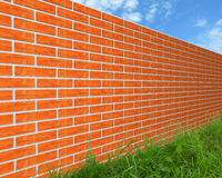 The brick wall on the grass. Stock Photo