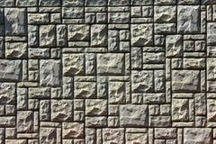 Brick wall. Wall of gray bricks of different shapes Royalty Free Stock Photo