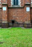 Brick wall on a green lawn royalty free stock photography