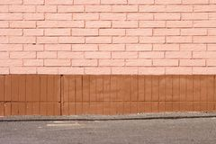 Brick wall and ground closeup Royalty Free Stock Image