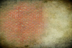 Brick wall on a grunge background Stock Photo