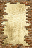 Brick wall grungy frame. Textured plaster background with grunge brick wall framing. Vertical image Royalty Free Stock Images