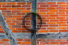 Brick wall of  half timbered house and iron hoop Royalty Free Stock Photos