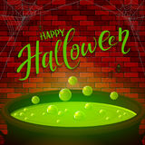 Brick wall and Halloween cauldron with green potion Royalty Free Stock Images
