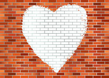 Brick wall hart. Put your text in the hart at the brick wall. Retro red brick wall  with a graffiti hart Royalty Free Stock Image