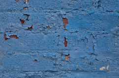 Brick wall that has been painted blue Stock Photos