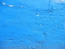 Blue brick wall. Brick wall that has been painted blue with peeling paint used as background texture pattern Royalty Free Stock Image