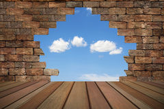 Brick wall with a hole. Royalty Free Stock Photography