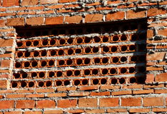Brick wall with holes Stock Image