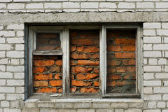 Brick wall with immured window Royalty Free Stock Photography
