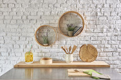 Brick wall interior with round frame and table Stock Photography