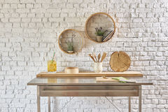 Brick wall interior with round frame and table Stock Photos