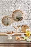 Brick wall interior with round frame and table Royalty Free Stock Photography