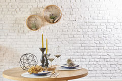 Brick wall interior with round frame and table royalty free stock image