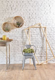 Brick wall interior with round frame and table Stock Photo