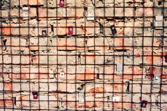 Brick wall with iron grid Royalty Free Stock Photos