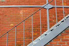 Brick Wall and Iron Stairs Royalty Free Stock Images