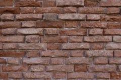 Brick wall with jagged bricks stock photography